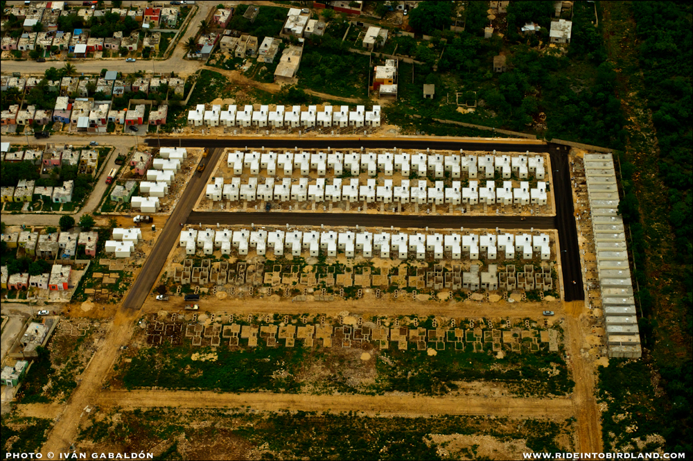 When those building materials are used to build human dwellings resembling windowless boxes, again I have to wonder: is this the best we can do? (Photo © Ivan Gabaldon - Aerial support provided by Lighthawk to Pronatura Peninsula de Yucatan).