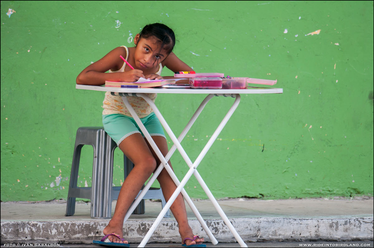 As she does her homework in the afternoon breeze, the future belongs to her. (Photo © Ivan Gabaldon).
